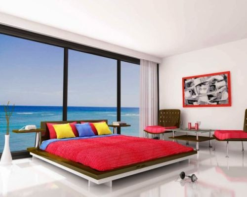 Bedroom on the sea with abstract paintings