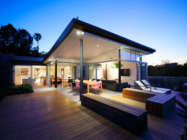 smart use of an l shaped home extension with sliding glass doors