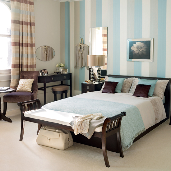 light blue striped wall in the bedroom