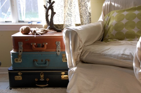 Suitcases stacked as a side table